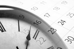 Sheet of a calendar with the number of days. And clock royalty free stock image