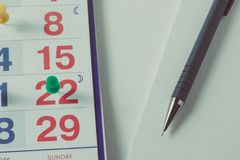 Sheet of a calendar and a pen close-up royalty free stock images