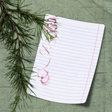 Sheet with christmas tree on green background Royalty Free Stock Photography