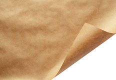Sheet of craft paper with curled corner Royalty Free Stock Photo