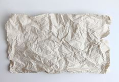Piece of crumpled paper on white background. stock images