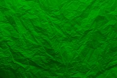 Crumpled paper of green color. A sheet of crumpled green paper stock photo