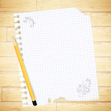 Sheet with drawing and pencil Stock Image