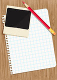 Sheet of exercise book and colored pencils. Stock Images