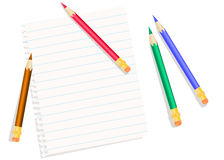 Sheet of exercise book and colored pencils Royalty Free Stock Photo