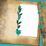 Sheet with flowers on old grunge background Royalty Free Stock Images