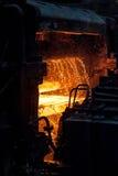 Sheet of hot metal on the conveyor belt Stock Photo