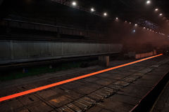Sheet of hot metal on the conveyor belt Royalty Free Stock Images
