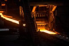 Sheet of hot metal on the conveyor belt Royalty Free Stock Photos