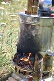Sheet iron antique turkish samovar to boil on nature, vertical photo. Turkey stock photos