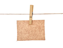 Sheet of kraft paper hanging Stock Photography