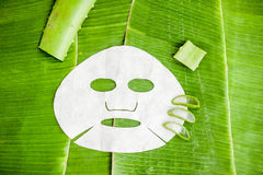 Sheet Mask with aloe on a background of banana leaf. Organic cosmetics concept Royalty Free Stock Photography