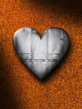 Sheet Metal Heart Against a Rusty Background Royalty Free Stock Photography