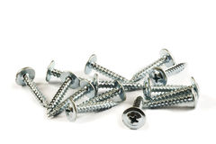 Sheet Metal Phillips Screws. A few sheet metal Phillips screws with a rounded washer head isolated over white background Stock Photography