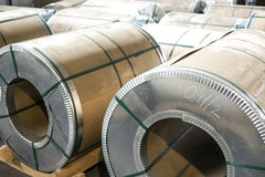 Sheet metal rolls in production hall Stock Photos