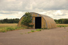 Sheet metal shelter with open door Royalty Free Stock Photo