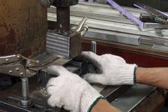 Sheet metal stamping process Stock Photography