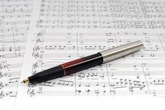 Sheet music. A pen on top of sheet music Stock Photo