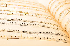 Sheet music. Close-up of sheet music in yellow lighting Royalty Free Stock Photo