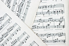 Sheet Music. Macro of three stained vintage music sheets Stock Photography