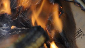 Sheet music burning in fire Stock Photography