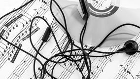 Sheet of music with CD and earphones Royalty Free Stock Photo