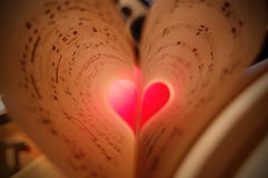 Sheet music. Close-up shot of two pages of sheet music folded into the shape of a heart Royalty Free Stock Photos