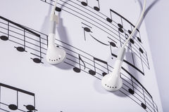 Sheet music and earphones Royalty Free Stock Photos
