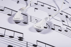 Sheet music and earphones Stock Images