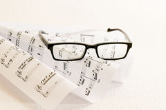 Sheet music an glasses Stock Photography