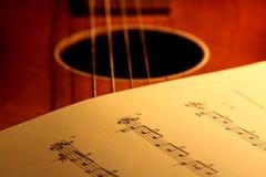 Sheet music on guitar 2 Stock Photo