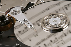 Sheet music and a hard disk Royalty Free Stock Image