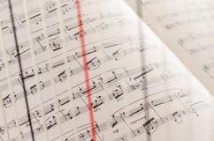 Sheet Music through Harp Strings.  royalty free stock photo