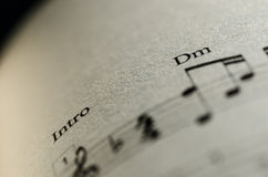 Sheet music note. Closeup Sheet music note and Dm chord stock photography