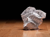 Sheet of music notes crumpled on the floor. Crumpled paper sheet of music notes on the floor, closeup,for music composition themes Royalty Free Stock Photos