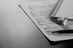 Sheet music with a number of accessories Stock Photos
