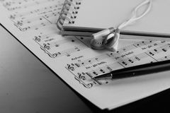 Sheet music with a number of accessories Stock Images