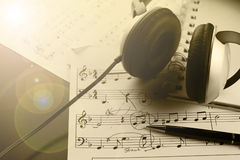 Sheet music with a number of accessories Stock Image