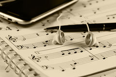 Sheet music with a number of accessories Royalty Free Stock Images