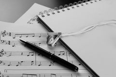 Sheet music with a number of accessories Royalty Free Stock Photography