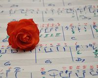 Sheet of music with an orange rose stock photo