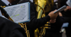 Sheet music. Orchestral band musician reading the sheet music Royalty Free Stock Images
