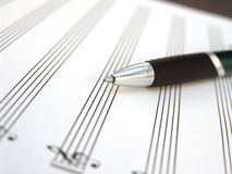 Sheet music with pen Stock Images
