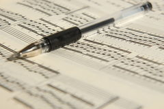 Sheet music and pen. An old music sheet and pen Stock Photography