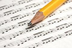 Sheet Music Pencil Notes Closeup. Closeup of Pencil lying on sheet music full of notes Stock Image