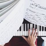 Person Practicing the Piano stock photo