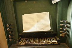 Sheet music on pipe organ. In fortified church the Saxon village of Copsa Mare in Transylvania, Romania Stock Photo