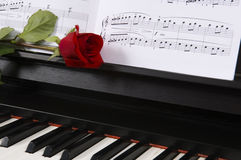 Sheet Music with Rose on piano Royalty Free Stock Images