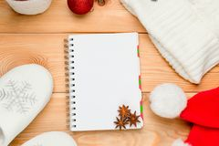 Sheet notepad for notes, anise and cap Santa`s top. View close-up Royalty Free Stock Images