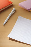 A sheet for notes on a wooden table. Royalty Free Stock Photography